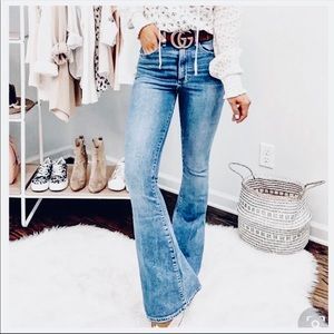 Mid Rise washed denim flared jeans